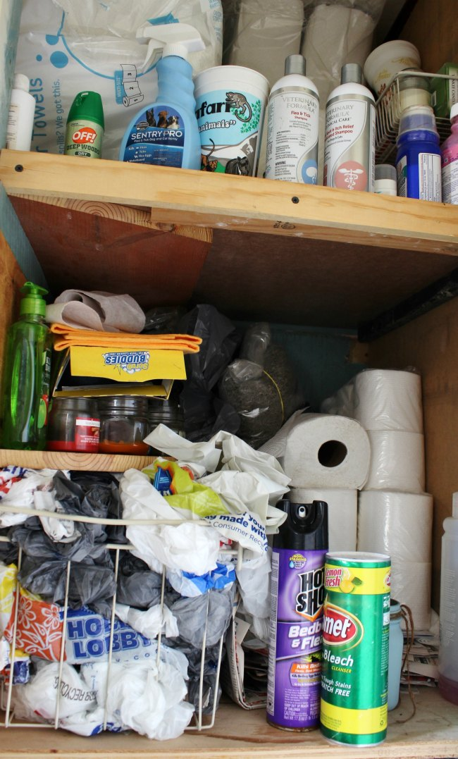 messy bathroom storage cabinet