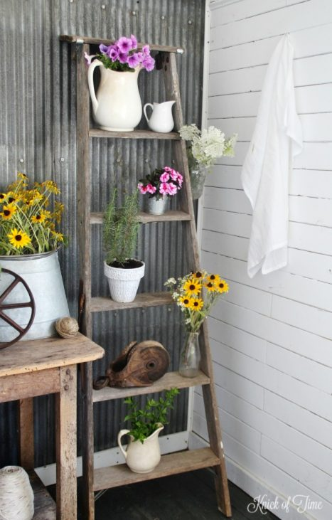 Repurpose an old ladder as a plant stand blooming with summer flowers - KnickofTime.net