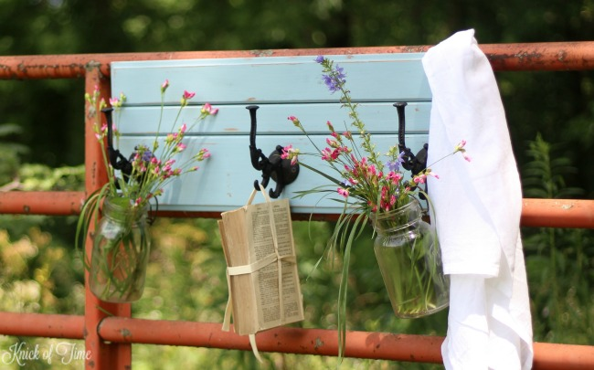 mason jars with flowers on farmhouse coat rack - Knick of Time