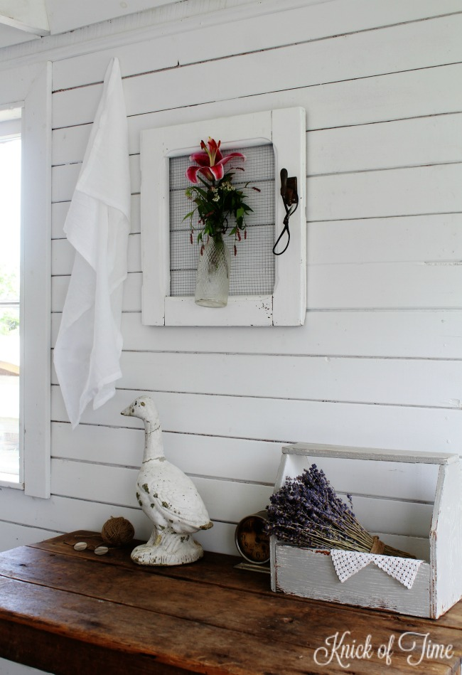 Turn old junk into farmhouse style home decor, like this salvaged cabinet door wall vase - KnickofTime.net