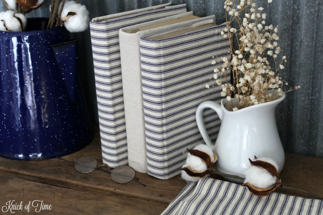 Ticking fabric and drop cloth canvas look beautiful as fabric covered books - KnickofTime.net