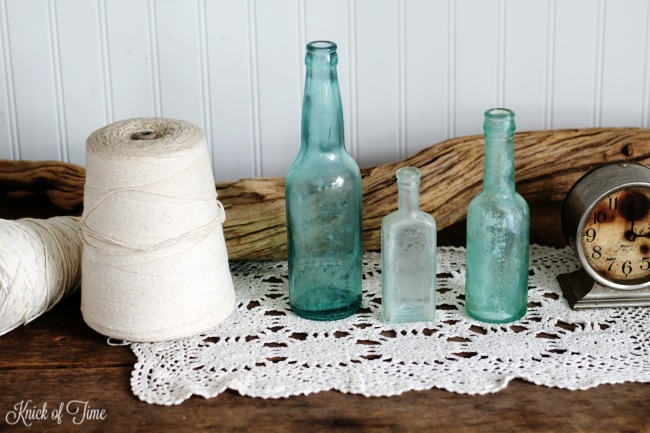 Vintage blue glass bottles for nautical beach decor - KnickofTime.net