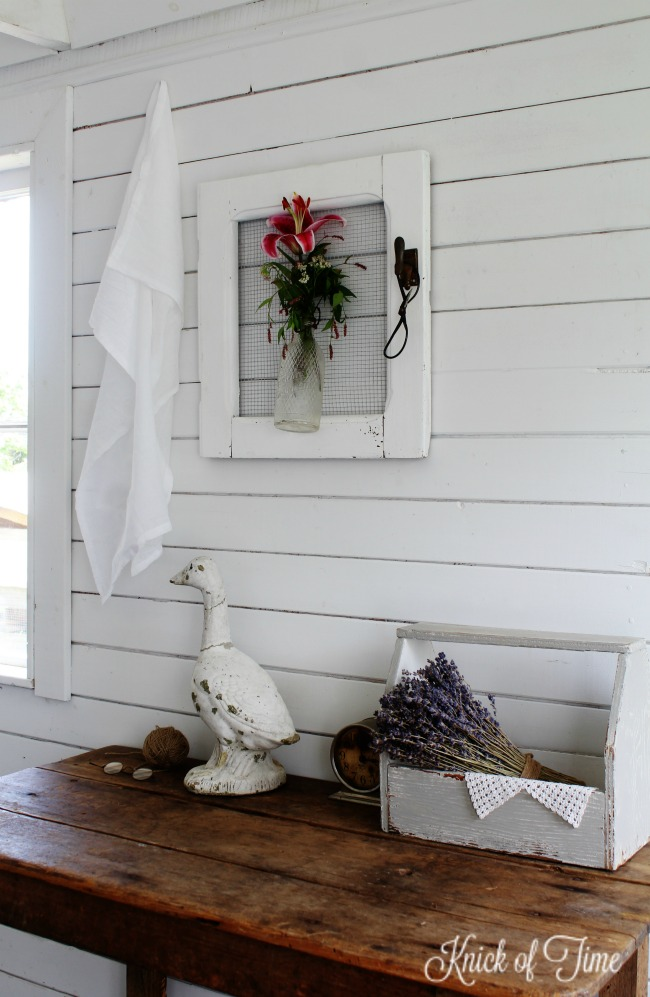 A salvaged old cabinet door makes a beautiful farmhouse style wall vase for flowers - KnickofTime.net