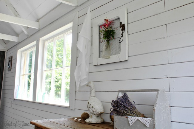White farmhouse guest room with vintage decor and upcycled junk treasures! - KnickofTime.net