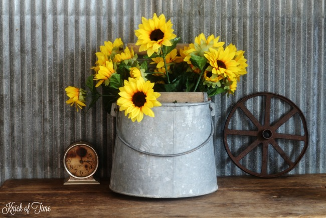 Turn old junk into unique flower planters | Sunflowers in galvanized mop bucket | www.knickoftime.net