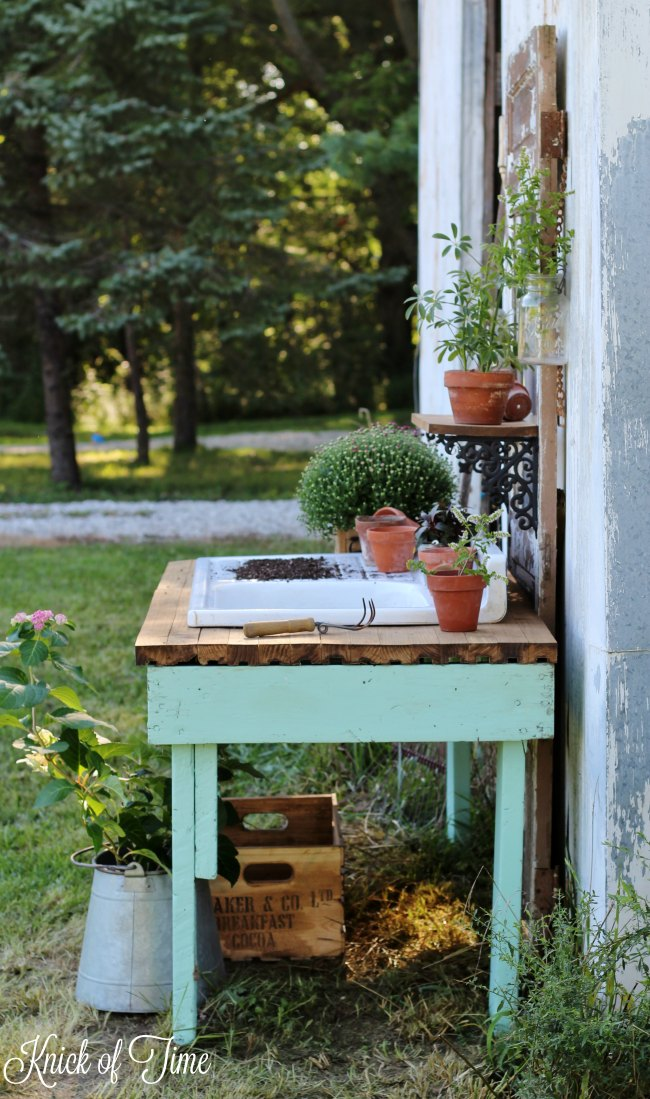 Old work table and vintage door repurposed potting bench | www.knickoftime.net