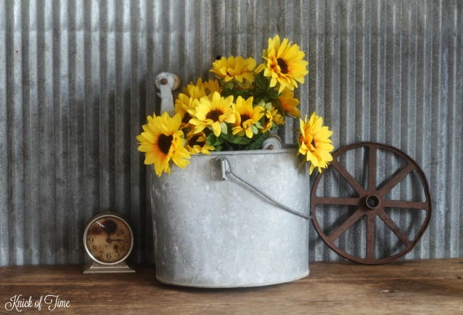 sunflowers in galvanized bucket