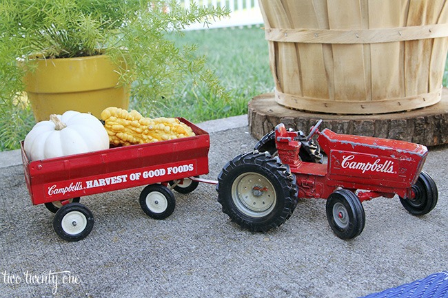 Toy tractor filled with gourds as fall patio decor featured at Talk of the Town - www.knickoftime.nnet