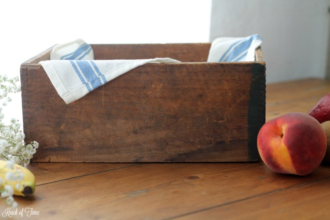 antique-crate-with-vintage-stripe-kitchen-towel-for-centerpiece-knick-of-time