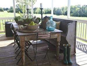 Fall farmhouse porch with antique farmhouse table and church pew featured at Talk of the Town - www.knickoftime.net