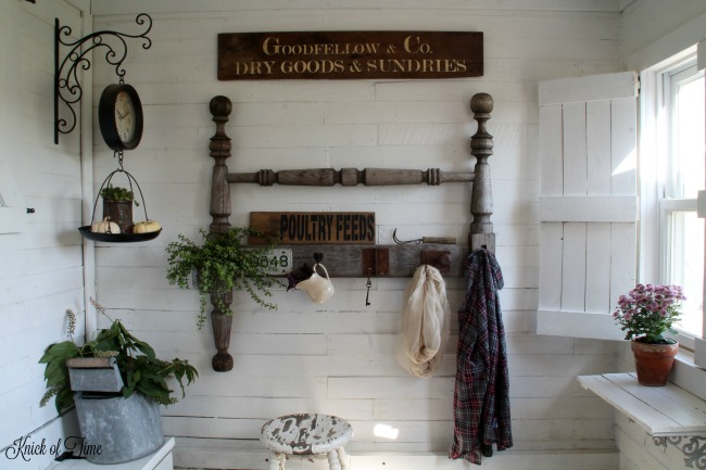 Farmhouse entryway repurposed antique wooden coat headboard turned into a coat rack | www.knickoftime.net