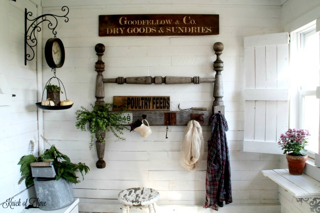 Farmhouse entryway with DIY salvaged headboard coat rack, wood window shutters and sign with Vintage Sign Stencils - www.KnickofTime.net