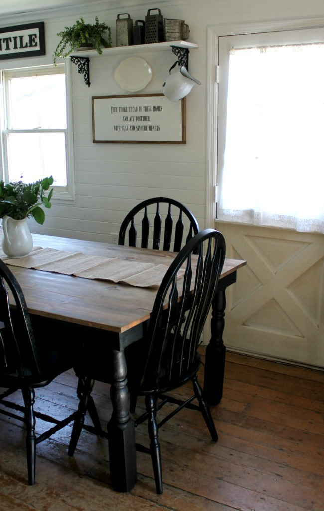 Farmhouse kitchen table and black painted chairs - www.knickoftime.net