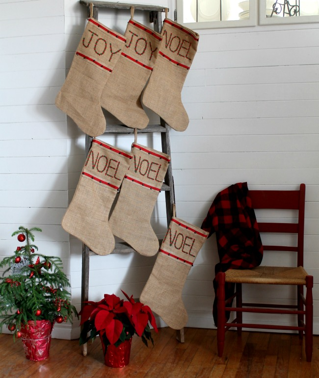 Turn an old wooden ladder into an easy farmhouse style Christmas stocking hanger - www.knickoftime.net