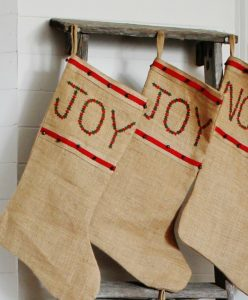 Turn an rustic old ladder into the perfect farmhouse Christmas stocking hanger! www.knickoftime.net