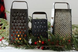 Create a simple Christmas candlelit centerpiece with vintage graters - www.knickoftime.net