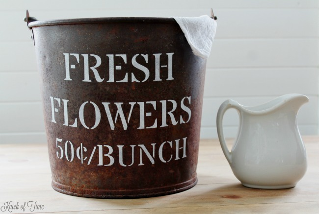 How to paint a fresh flowers sign on a rusty metal farmhouse bucket with FLOWER SHOP stencil | Knick of Time's Vintage Sign Stencils | knickoftime.net