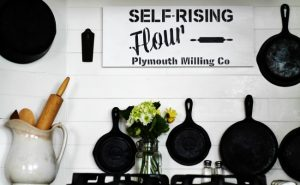Farmhouse Kitchen Decorating Stenciled Wooden Sign and Spring Flowers