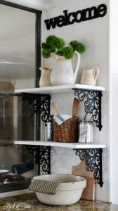white farmhouse kitchen shelves with ironstone pitchers, woven utensil basket and decorative glass jars | knickoftime.net