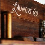 Laundry Room Sign Stenciled on Salvaged Wood Shelf