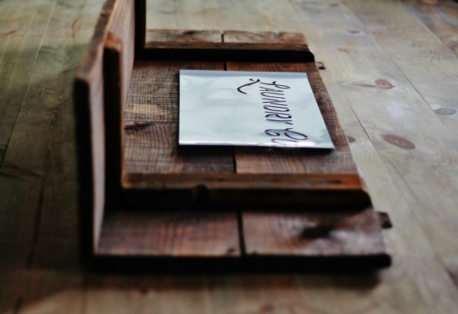 stencilling-a-laundry-room-sign-on-salvaged-barn-wood-shelf-knick-of-time