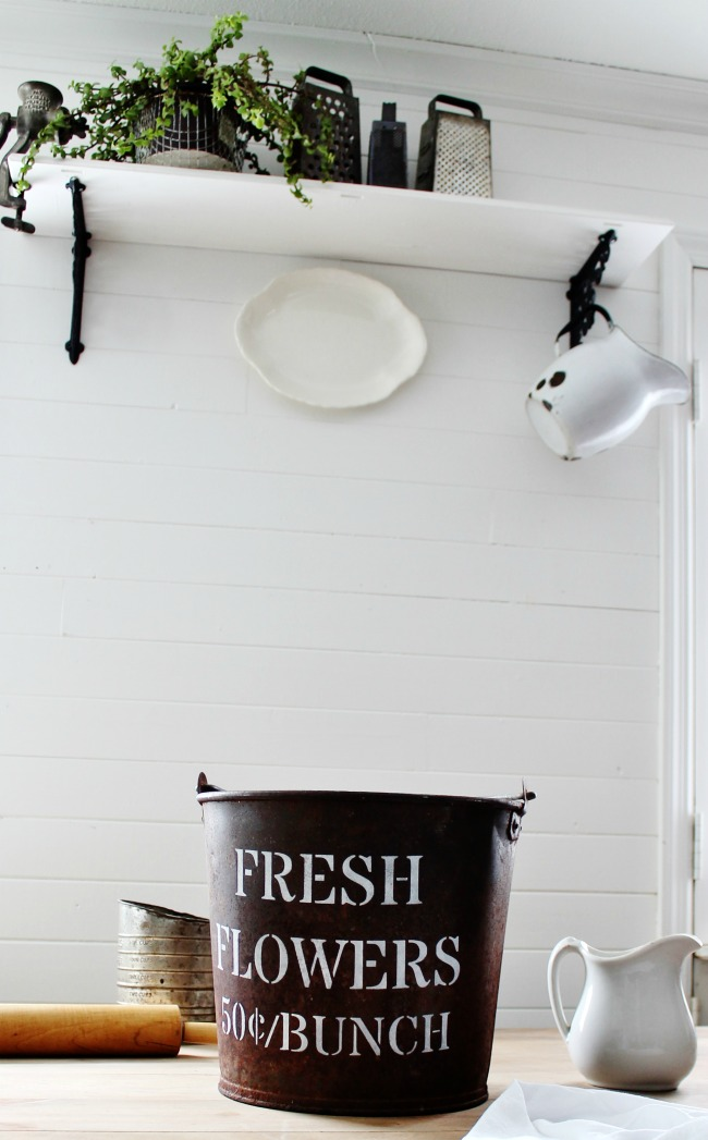 Turning a rusty old barn bucket into an industrial farmhouse FLOWER SHOP bucket with Knick of Time Vintage Sign Stencils |knickoftime.net