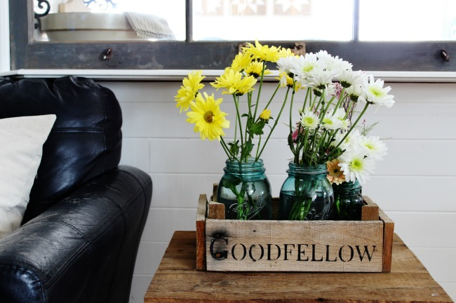 Spring flowers in a rustic wood crate with DIY farmhouse painted pillows | www.knickoftime.net