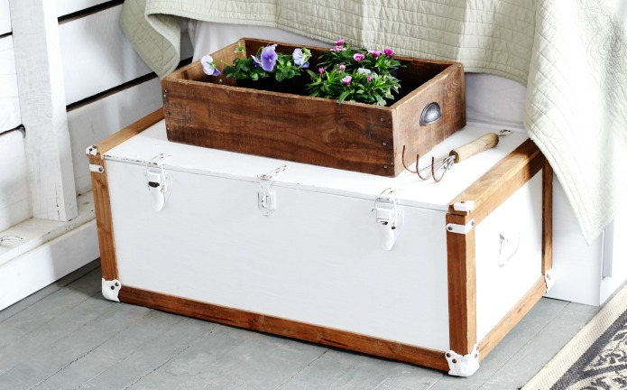 A painted vintage trunk looks great at the foot of a bed and offers extra bedroom storage as well | www.knickoftime.net