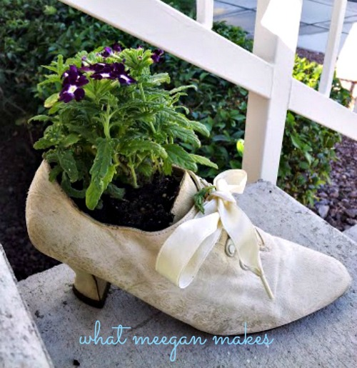 Repurposed Flowers in Shoe Garden | 15 Creative Repurposed and Upcycled Planter Ideas featured at Knick of Time | www.knickoftime.net