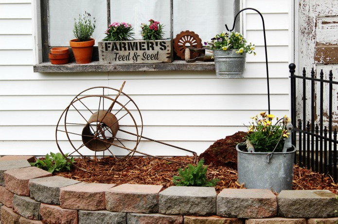 Farmhouse window box and rusty junk decor in flower bed | www.knickoftime.net
