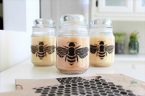 Stenciled dollar store candle jars featured at Talk of the Town at Knick of Time
