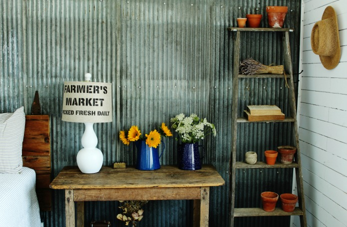 Farmhouse guest house with upcycled painted lamp, farmer's market stenciled lamp shade and sunflowers and wildflowers in vintage enamelware pitchers | www.knickoftime.net