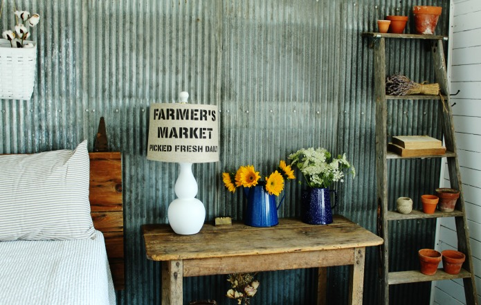 Farmhouse guest room with vintage decor, repurposed wooden ladder and fresh flowers | www.knickoftime.net