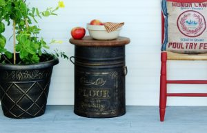 How to turn an antique metal flour bin into a farmhouse style side table by Knick of Time | www.knickoftime.net