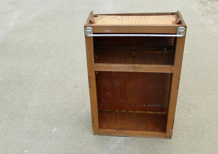 A rickety Craigslist cabinet to repurpose into a rustic paint supplies cart | www.knickoftime.net