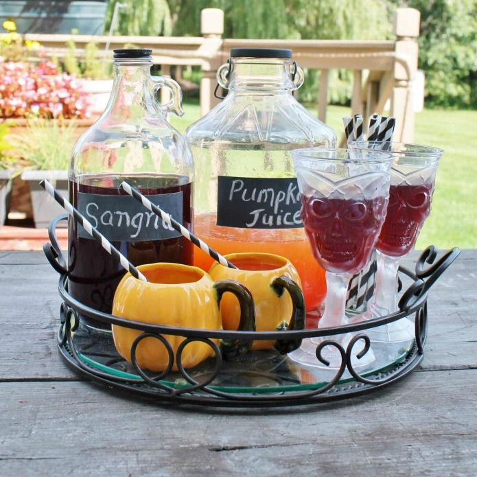 Chalkboard Labels on Vintage Drink Jugs for Halloween by Adirondack Girl at Heart