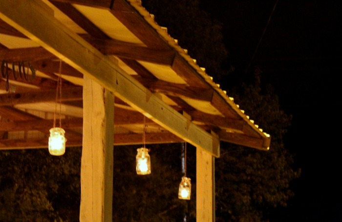 Outdoor wedding reception hanging mason jar candle holders | www.knickoftime.net