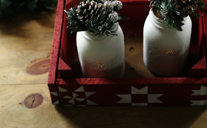 painted and distressed mason jars in a rustic farmhouse style Christmas table centerpiece made with Vintage Sign Stencils by Knick of Time| www.knickoftime.net