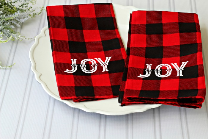 Easy DIY Red and Black Buffalo Check Cloth Bandana Napkins made with Chalk Couture Peace Joy Believe transfer set. Tutorial at Knick of Time | knickoftime.net