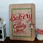 Mrs Claus Bakery and Candy Shop on large wood cutting board made with Chalk Couture transfer by Knick of Time | knickoftime.net