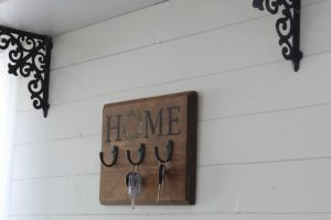 Chalk Couture Home & Wreath on wood plaque on ship lap wall by Knick of Time