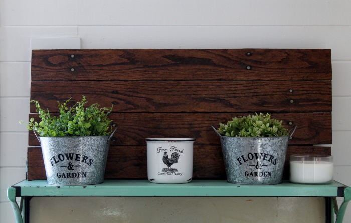 Create a Rustic Farmhouse Pallet Indoor Garden Using Dollar Tree Galvanized Planters. See how at Knick of Time | knickoftime.net