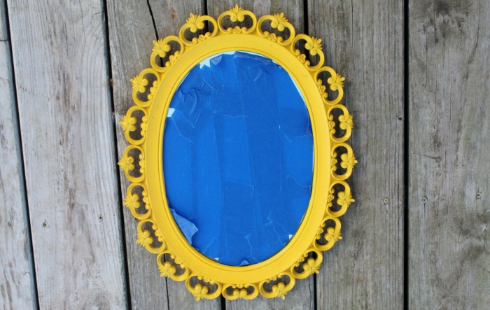 Paint an old mirror and turn it into spooky fun Halloween decor!