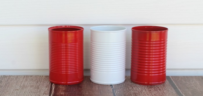 Red and white painted tin cans for Christmas Hot Cocoa Station
