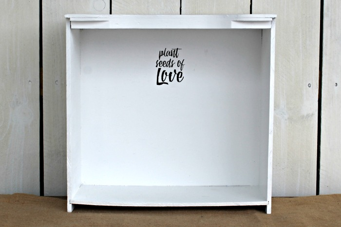 Farmhouse adhesive stencil design plant seeds of love on a painted drawer to become a plant stand